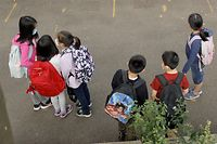 NEW YORK, NEW YORK - SEPTEMBER 27: Students line up in the morning at Yung Wing School P.S. 124 on September 27, 2021 in New York City. New York City schools fully reopened earlier this month with all in-person classrooms and mandatory masks on students. The city's mandate ordering all New York City school staff to be vaccinated by midnight today was delayed again after a federal appeals court issued a temporary injunction three days before the mayor's deadline.   Michael Loccisano/Getty Images/AFP == FOR NEWSPAPERS, INTERNET, TELCOS & TELEVISION USE ONLY ==