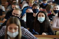 Students of the Russian University of Transport wearing face masks attend a lecture in Moscow on October 5, 2020, amid the ongoing coronavirus pandemic. - Russia confirmed 10,888 new Covid-19 cases on October 5, bringing the country�s official amount to 1,225,889 as the number of new infections across the country continues to rise. (Photo by Natalia KOLESNIKOVA / AFP)