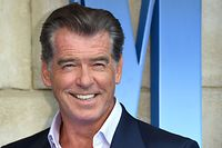 """Pierce Brosnan poses on the red carpet upon arrival for the world premiere of the film """"Mamma Mia! Here We Go Again"""" in London on July 16, 2018.  / AFP PHOTO / -"""