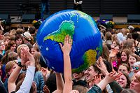"TOPSHOT - Protesters throw an earth-shaped ball during the ""Global Strike For Future"" demonstration in Stockholm on May 24, 2019, a global day of student protests aiming to spark world leaders into action on climate change. - In a shift since the last European Parliament elections, mainstream parties have adopted climate change as a rallying cry -- spurred in part by a wave of student strikes. A Eurobarometer poll shows climate change is now a leading concern for European Union voters, not far behind economic issues and rivalling worries about migration. (Photo by Jonathan NACKSTRAND / AFP)"