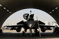A French Rafale pilot prepares to take off at the Kandahar Air Base on February 11, 2008.  Two Rafale took off on two mixed patrols along with two Mirage 2000 D aircraft on their first ever mission from the aerial base of Kandahar in southern Afghanistan to assist ground forces of NATO during Operation Enduring Freedom, if required.   Rafale fighters have already served in the Afghan theater, but flew from the Tadjick capital air base of Duchanbe for a period of four months in 2007.  AFP PHOTO/SHAH Marai