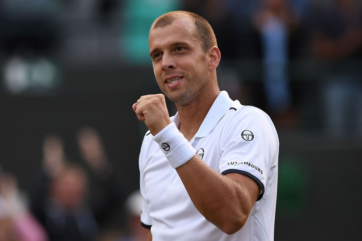Luxembourg's Gilles Muller reacts after winning against Spain's Rafael Nadal during their men's singles fourth round match on the seventh day of the 2017 Wimbledon Championships at The All England Lawn Tennis Club in Wimbledon, southwest London, on July 10, 2017. Muller won the match 6-3, 6-4, 3-6, 4-6, 15-13. / AFP PHOTO / Glyn KIRK / RESTRICTED TO EDITORIAL USE