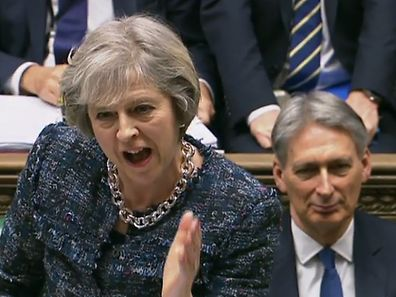 "A video grab from footage broadcast by the UK Parliament's Parliamentary Recording Unit (PRU) shows British Chancellor of the Exchequer Philip Hammond (R) as he listens to British Prime Minister Theresa May speak during the weekly Prime Minister's Questions (PMQs) in the House of Commons in London on January 18, 2017. Prime Minister Theresa May unveiled her Brexit blueprint on January 17, 2017, announcing for the first time that Britain will leave Europe's single market in order to control EU immigration. / AFP PHOTO / PRU AND AFP PHOTO / HO / RESTRICTED TO EDITORIAL USE - MANDATORY CREDIT "" AFP PHOTO / PRU "" - NO MARKETING NO ADVERTISING CAMPAIGNS - NO RESALE - NO DISTRIBUTION TO THIRD PARTIES - 24 HOURS USE - NO ARCHIVES"