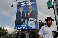 An Isreaeli man drives past an election billboard for the Likud party, showing US President Donald Trump (L) shaking hands with Likud chairman and Prime Minister Benjamin Netanyahu in Jerusalem on September 16, 2019. (Photo by AHMAD GHARABLI / AFP)