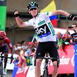 """Sky's British cyclist Christopher Froome (R) celebrates as he crosses the finish line followed by Movistar's Spanish Alejandro Valverde during the 11th stage of the 71st edition of """"La Vuelta"""" Tour of Spain, a 168,6 km route between Colunga and Pena Cabarga, on August 31, 2016. / AFP PHOTO / JOSE JORDAN"""