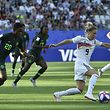 Nigeria's defender Chidinma Okeke (L) vies with Germany's midfielder Svenja Huth during the France 2019 Women's World Cup round of sixteen football match between Germany and Nigeria, on June 22, 2019, at the Stades des Alpes stadium in Grenoble, central eastern France. (Photo by Jean-Philippe KSIAZEK / AFP)