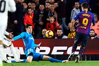 Barcelona's Uruguayan forward Luis Suarez scores his third goal during the Spanish league football match between FC Barcelona and Real Madrid CF at the Camp Nou stadium in Barcelona on October 28, 2018. (Photo by GABRIEL BOUYS / AFP)