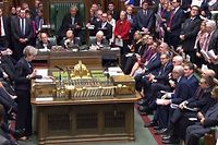"A video grab from footage broadcast by the UK Parliament's Parliamentary Recording Unit (PRU) shows Britain's Prime Minister Theresa May making a statement in the House of Commons in London on December 10, 2018. - Theresa May told the house that the Brexit withdrawal bill will be deferred. (Photo by HO / PRU / AFP) / RESTRICTED TO EDITORIAL USE - NO USE FOR ENTERTAINMENT, SATIRICAL, ADVERTISING PURPOSES - MANDATORY CREDIT "" AFP PHOTO / PRU """