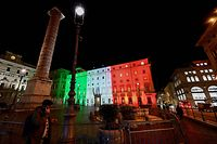 A view taken on January 12, 2021 in Rome shows the Palazzo Chigi, the seat of the Italian government, lit with the colors of the Italian flag as Italy's government is later expected to discuss a 220-billion-euro coronavirus recovery spending package. - Italy was on the brink of a government crisis on January 12 as ex-premier Matteo Renzi was widely expected to withdraw his small but pivotal Italy Alive (Italia Viva, or IV) party from the ruling centre-left coalition after complaining that the EU funds risked being wasted. (Photo by Vincenzo PINTO / AFP)