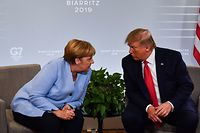 (FILES) In this file photo taken on August 26, 2019 German Chancellor Angela Merkel (L) and US President Donald Trump speak during a bilateral meeting in Biarritz, south-west France on August 26, 2019, on the third day of the annual G7 Summit. - German Chancellor Angela Merkel will not attend an in-person summit of G7 leaders that US President Donald Trump has suggested he will host despite concerns over the coronavirus pandemic, according with German government spokesman. (Photo by Nicholas Kamm / AFP)