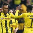 Dortmund's Gabonese forward Pierre-Emerick Aubameyang (C) celebrates scoring the 3-1 with Dortmund's French midfielder Ousmane Dembele during the German First division Bundesliga football match between Borussia Dortmund and Bayer 04 Leverkusen in Dortmund, western Germany, on March 4, 2017.  / AFP PHOTO / dpa / Friso Gentsch / Germany OUT / RESTRICTIONS: DURING MATCH TIME: DFL RULES TO LIMIT THE ONLINE USAGE TO 15 PICTURES PER MATCH AND FORBID IMAGE SEQUENCES TO SIMULATE VIDEO. == RESTRICTED TO EDITORIAL USE == FOR FURTHER QUERIES PLEASE CONTACT DFL DIRECTLY AT + 49 69 650050