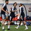 TOPSHOT - CORRECTION - (From L) France's forward Olivier Giroud, France's forward Antoine Griezmann and France's forward Kylian Mbappe attend a training session at the National stadium in Andorra La Vella, on June 10, 2019  on the eve of the UEFA Euro 2020 qualification football match between Andorra and France. (Photo by FRANCK FIFE / AFP) / �The erroneous mention[s] appearing in the metadata of this photo by FRANCK FIFE has been modified in AFP systems in the following manner: [on the eve of the UEFA Euro 2020 qualification football match] instead of [UEFA nations League football match]. Please immediately remove the erroneous mention[s] from all your online services and delete it (them) from your servers. If you have been authorized by AFP to distribute it (them) to third parties, please ensure that the same actions are carried out by them. Failure to promptly comply with these instructions will entail liability on your part for any continued or post notification usage. Therefore we thank you very much for all your attention and prompt action. We are sorry for the inconvenience this notification may cause and remain at your disposal for any further information you may require.�