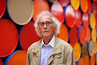 "Bulgarian artist Christo poses in front of the monumental ""Mastaba"" art work at the Maeght Foundation (Fondation Maeght) on the opening day of the exibition on June 4, 2016 in Saint-Paul, southeastern France.  The exibition takes place from June 6 to November 27, 2016.   / AFP PHOTO / VALERY HACHE / RESTRICTED TO EDITORIAL USE - MANDATORY MENTION OF THE ARTIST UPON PUBLICATION - TO ILLUSTRATE THE EVENT AS SPECIFIED IN THE CAPTION"