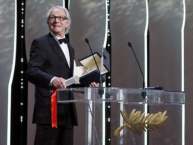"""Director Ken Loach, Palme d'Or award winner for his film """"I, Daniel Blake"""", reacts during the closing ceremony of the 69th Cannes Film Festival in Cannes, France, May 22, 2016. REUTERS/Yves Herman"""