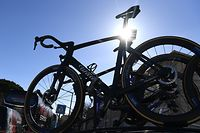 This picture taken on March 13, 2020 show bicycles fixed on the roof of a official cycling team car prior the start of the 161,5 km,  6th stage of the 78th Paris - Nice cycling race stage between Sorgues  and Apt, on March 13, 2020. - The organizers of the 78th Paris-Nice cycling race announced on March 13, 2020 the cancellation of the last stage scheduled for Sunday due to the coronavirus pandemic. (Photo by Alain JOCARD / AFP)
