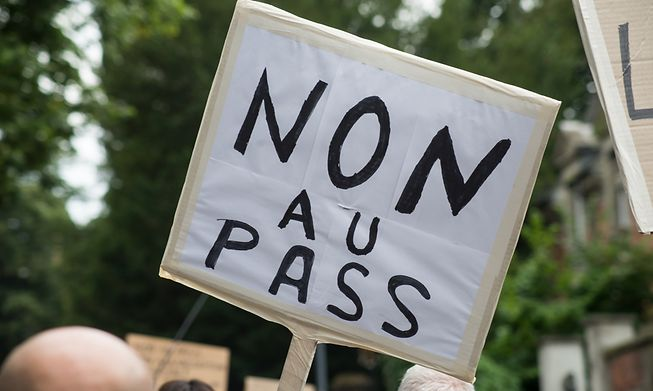 Protesters speaking out against the so-called Covid passport