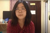 """This screengrab taken on December 28, 2020 from an undated video showing former Chinese lawyer and citizen journalist Zhang Zhan as she broadcasts via YouTube, at an unconfirmed location in China. - Zhang was jailed for four years on December 28, 2020 by a court in Shanghai for her reporting from Wuhan as the Covid-19 outbreak unfurled, her lawyer said, almost a year after details of an """"unknown viral pneumonia"""" surfaced in the central China city. (Photo by Handout / YOUTUBE / AFP) / -----EDITORS NOTE --- RESTRICTED TO EDITORIAL USE - MANDATORY CREDIT """"AFP PHOTO / YouTube"""" - NO MARKETING - NO ADVERTISING CAMPAIGNS - DISTRIBUTED AS A SERVICE TO CLIENTS  - NO ARCHIVES"""