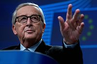 European Commission President Jean-Claude Juncker gestures during his last presser in Brussels on November 29, 2019. - The 64-year-old head of the EU's executive is at the end of his five-year mandate and is expected to hand over the reins to his successor on December 1, 2019. (Photo by Kenzo TRIBOUILLARD / AFP)