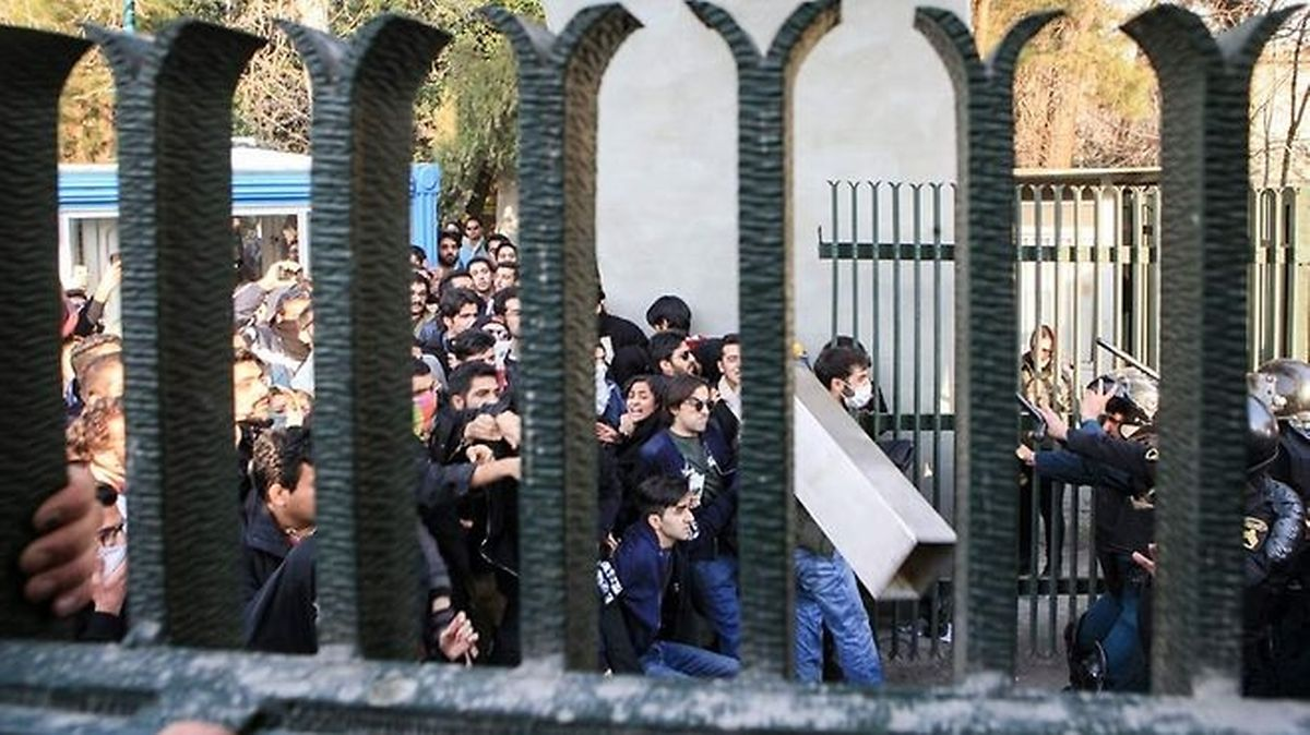 Iranian students scuffle with police at the University of Tehran during a demonstration driven by anger over economic problems (AFP)