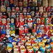 Matryoshka dolls, also known as Russian stacking dolls, featuring players in the Russia 2018 World Cup football tournament are seen on sale at Izmailovo flea market in Moscow on July 13, 2018. / AFP PHOTO / Maxim Zmeyev