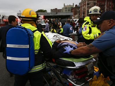 NEW YORK, NY - SEPTEMBER 29: People are treated for their injuries outside after a NJ Transit train crashed in to the platform at Hoboken Terminal September 29, 2016 in Hoboken, New Jersey. Dozens are reported injured from the rush hour accident in the terminal that handles up to 50,000 passengers a day.   Eduardo Munoz Alvarez/Getty Images/AFP == FOR NEWSPAPERS, INTERNET, TELCOS & TELEVISION USE ONLY ==