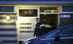 """Dutch police officers carry out an investigation in the Oudenoord neighbourhood of Utrecht, on March 18, 2019, following a shooting on a tram. - Dutch police arrested a Turkish-born suspect on March 18, over a possible terror attack on a tram in the city of Utrecht that left three people dead and five wounded. Dutch authorities said they were still investigating a likely terrorist motive for the attack but said they """"cannot exclude"""" other motives, including a family dispute. (Photo by Robin van Lonkhuijsen / various sources / AFP) / Netherlands OUT"""