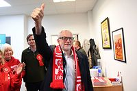 Opposition Labour party leader Jeremy Corbyn gestures as he arrives to take part in a phone banking session in Glasgow, Scotland on December 10, 2019, as campaigning in the general election enters it's final days. - Britain will go to the polls on December 12, 2019 to vote in a pre-Christmas general election. (Photo by ANDY BUCHANAN / AFP)