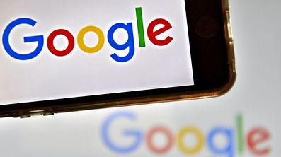 "(FILES) This file photo taken on December 28, 2016 shows logos of US multinational technology company Google in Veryou.    Google said June 23, 2017 it would stop scanning the contents of Gmail users' inboxes for ad targeting, moving to end a practice that has fueled privacy concerns since the free email service was launched. A Google statement said Gmail users would still see ""personalized"" ads and marketing messages but these would be based on other data, which may include search queries or browsing habits.  / AFP PHOTO / LOIC VENANCE"