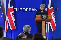 British Prime Minister Theresa May speaks on March 21, 2019, on the first day of an EU summit focused on Brexit, in Brussels. - European Union leaders meet in Brussels on March 21 and 22, for the last EU summit before Britain's scheduled exit of the union. (Photo by EMMANUEL DUNAND / AFP)