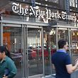 (FILES) In this file photo taken on September 6, 2018 people walk with their smartphones in front of the New York Times building in New York. - Social media has overtaken print newspapers as a news source for Americans, researchers said December 10, 2018, highlighting the growing importance of services such as Facebook and Twitter as well as the troubled state of legacy news organizations. The Pew Research Center report found 20 percent of US adults say they often get news via social media, compared with 16 percent from newspapers. (Photo by ANGELA WEISS / AFP)