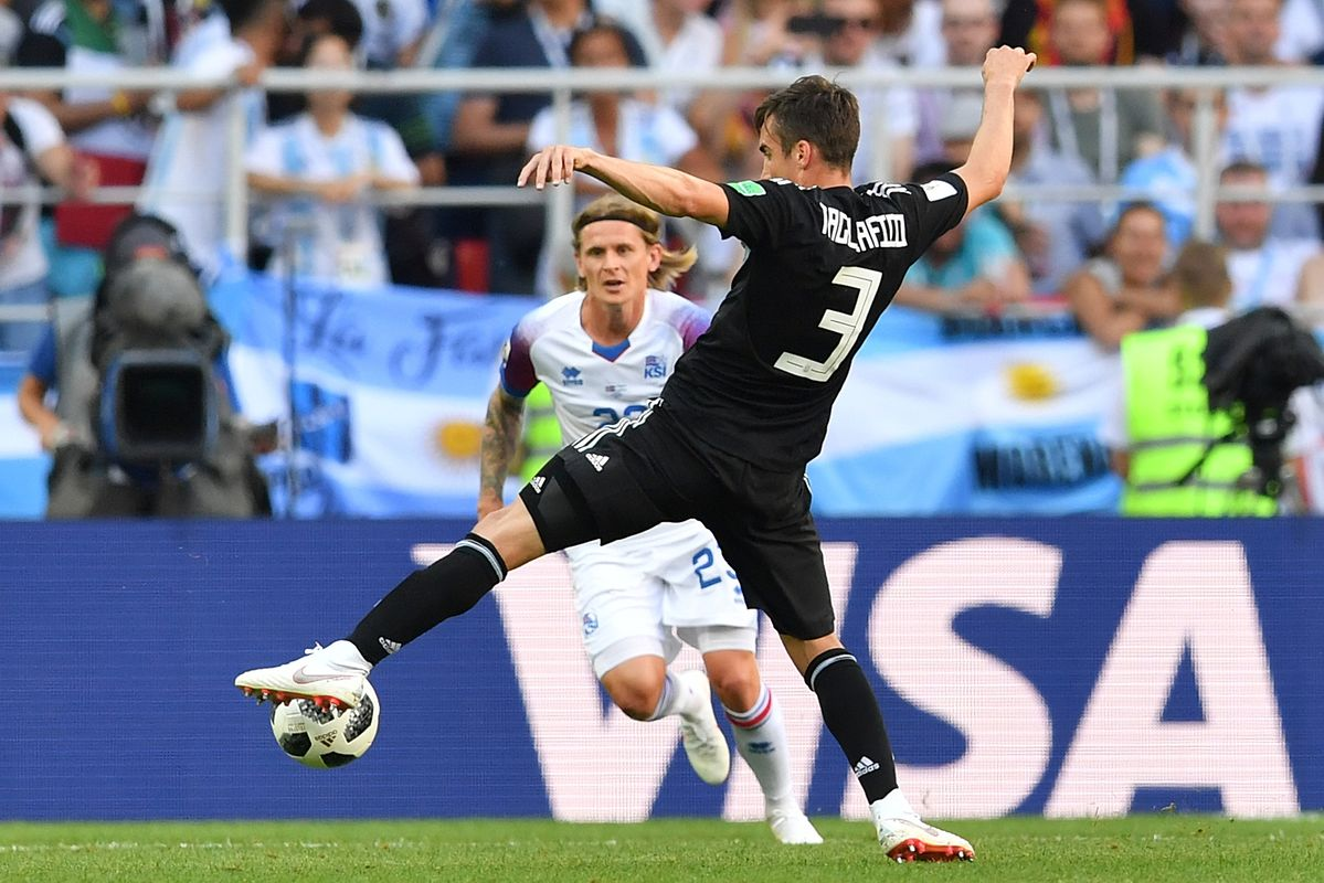 Argentina's defender Nicolas Tagliafico challenges Iceland's defender Ari Skulason (back) during the Russia 2018 World Cup Group D football match between Argentina and Iceland at the Spartak Stadium in Moscow on June 16, 2018. / AFP PHOTO / Yuri CORTEZ / RESTRICTED TO EDITORIAL USE - NO MOBILE PUSH ALERTS/DOWNLOADS