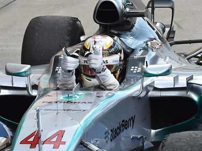 Mercedes driver Lewis Hamilton of Britain celebrates his victory after the Formula One Japanese Grand Prix at the Suzuka circuit in Suzuka on September 27, 2015.    AFP PHOTO / KAZUHIRO NOGI