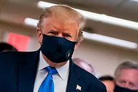 (FILES) In this file photo taken on July 11, 2020 US President Donald Trump wears a mask as he visits Walter Reed National Military Medical Center in Bethesda, Maryland. - US President Donald Trump, who for months refused to encourage mask wearing as a way to combat the coronavirus, on July 20, 2020 tweeted a picture of himself with his face covered and touted his patriotism. (Photo by ALEX EDELMAN / AFP)