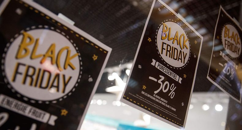 A picture shows signs price markdown signs for Black Friday sales in a shop in Caen, northwestern France, on November 27, 2019. - Black Friday is a sales offer originating from the US where retailers slash prices on the day after the Thanksgiving holiday. (Photo by Sameer Al-DOUMY / AFP)