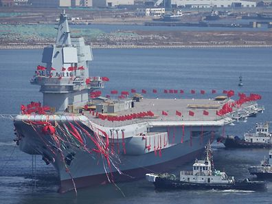 China's first domestically built aircraft carrier is seen during its launching ceremony in Dalian, Liaoning province, China, April 26, 2017. REUTERS/Stringer ATTENTION EDITORS - THIS IMAGE WAS PROVIDED BY A THIRD PARTY. EDITORIAL USE ONLY. CHINA OUT. NO COMMERCIAL OR EDITORIAL SALES IN CHINA.