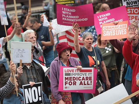 CHICAGO, IL - MARCH 24: Demonstrators gather near Trump Tower to celebrate the defeat of President Donald Trump's revision of the Affordable Care Act (ACA) on March 24, 2017 in Chicago, Illinois. After failing to get enough support within their own party, House Republican leaders pulled the legislation to repeal the ACA from consideration today.   Scott Olson/Getty Images/AFP == FOR NEWSPAPERS, INTERNET, TELCOS & TELEVISION USE ONLY ==