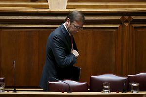 Portugal's Prime Minister Pedro Passos Coelho leaves his seat during a debate on government programs at the parliament in Lisbon, Portugal November 10, 2015. Leftwing parties looked set to oust Portugal's minority centre-right government on Tuesday in a parliamentary vote, part of a drive to set up their own Socialist-led administration they hope will put an end to years of harsh austerity.  REUTERS/Rafael Marchante