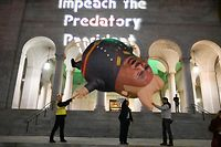 "Protestors prepare to release a ""Comrade Trump"" balloon at a demonstration in support of the impeachment of U.S. President Donald Trump, on the eve of the expected House of Representative impeachment vote, December 17, 2019 in downtown Los Angeles, California. (Photo by Robyn Beck / AFP)"