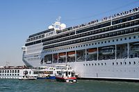 TOPSHOT - Rescuing boats of the Carabinieri Police (Front) and the port's fire rescue service (2ndL) assist the damaged River Countess tourist boat (Rear L) after it was hit early on June 2, 2019 by the MSC Opera cruise ship (R) that lost control as it was coming in to dock in Venice, Italy. - Tourists on land could be seen running away as the MSC Opera scraped along the dockside, its engine blaring, before knocking into the River Countess tourist boat. (Photo by Andrea PATTARO / AFP)
