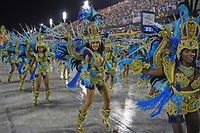 (FILES) In this file photo taken on February 24, 2020 members of Vila Isabel samba school perform during the last night of Rio's Carnival parade at the Sambadrome Marques de Sapucai in Rio de Janeiro, Brazil. - Rio de Janeiro indefinitely postponed world-famous carnival over Covid-19 on September 24, 2020. (Photo by CARL DE SOUZA / AFP)