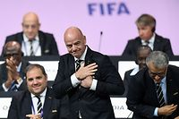 FIFA President Gianni Infantino (C) reacts after being re-elected by acclamation for a second term at the 69th FIFA Congress at Paris Expo, Porte de Versailles in Paris on June 5, 2019. - The 49 year-old, who took charge of FIFA in February 2016 after the departure of the disgraced Sepp Blatter, stood unopposed for re-election for a new four-year term which will run until 2023. (Photo by FRANCK FIFE / AFP)