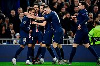 Paris Saint-Germain's Spanish midfielder Pablo Sarabia (3L) celebrates his goal with teammates during the UEFA Champions League group A football match against Paris Saint-Germain FC at the Santiago Bernabeu stadium in Madrid on November 26, 2019. (Photo by JAVIER SORIANO / AFP)