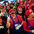 "Cosplayers dressed as character ""Mario"" celebrate the 30th anniversary of ""Super Mario Bros."" video games developed by Nintendo during the Gamescom 2015 fair in Cologne, Germany August 6, 2015. The Gamescom convention, Europe's largest video games trade fair, runs from August 5 to August 9. REUTERS/Kai Pfaffenbach"