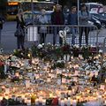 Candles and flowers have been left at the makeshift memorial for the victims of Friday's stabbings at the Turku Market Square, Finland.