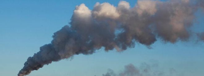 """(FILES) This file photo taken on November 22, 2015 shows smoke billowing from a heating factory in Heihe, in northeastern China's Heilongjiang province.  Carbon emissions from burning fossil fuels have been nearly flat for three years in a row -- a """"great help"""" but not enough to stave off dangerous global warming, a report said on November 14, 2016.  / AFP PHOTO / STRINGER / TO GO WITH AFP STORY BY MARIETTE LE ROUX"""