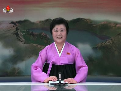 A North Korean television anchorwoman announcing the launch of the country's earth observation satellite Kwangmyong 4.