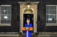 Britain's Prime Minister Theresa May delivers a statement to members of the media in Downing Street in London on January 16, 2019, after surviving a vote of no confidence in her government. - British Prime Minister Theresa May's government saw off a vote of no confidence in parliament on Wednesday, called after MPs overwhelmingly rejected the Brexit deal. (Photo by Ben STANSALL / AFP)