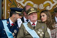 (FILES) In this file photo taken on October 12, 2012 (fromL) Spain's Crown Prince Felipe, Spain's King Juan Carlos and Spain's Princess Letizia attend the Spanish National day military parade in Madrid on October 12, 2012. - Spain's former king Juan Carlos, who is under investigation for corruption, has announced he plans to go into exile, the royal palace said on August 2, 2020. (Photo by DOMINIQUE FAGET / AFP)