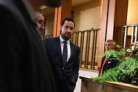 "(FILES) In this file photo taken on September 19, 2018 the former Elysee senior security officer Alexandre Benalla (C) leaves a Senate committee as he is quizzed over his close ties to France's leader in Paris. - Benalla has been placed under police custody, suspected of ""forgery and falsification"" in the case of his diplomatic passports, AFP reported on January 17, 2019. (Photo by Alain JOCARD / AFP)"