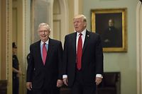 (FILES) In this file photo taken on October 23, 2017 President Donald Trump (R) and Senate Majority Leader Mitch McConnell (R-KY) walk to a lunch with Senate Republicans on Capitol Hill, October 24, 2017 in Washington, DC. - Donald Trump urged Republican senators February 16, 2021 to dump Mitch McConnell as their leader in the Senate following his withering criticism of the former US president after his impeachment trial. (Photo by Drew Angerer / GETTY IMAGES NORTH AMERICA / AFP)